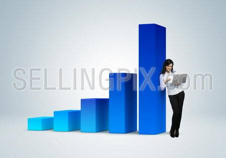 Financial report & statistics. Business success concept. Business woman with notebook stands by the bar graph.