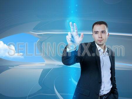 Young stylish businessman touching virtual interface button. Pillar of transparent blue light. Future bio style interior on background. Interfaces collection.